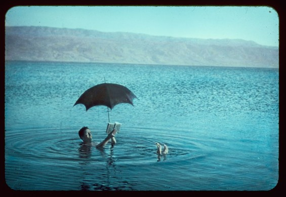 Dead Sea. Man with book and sunshade floating to show bouyancy [i.e., buoyancy] Library of Congress: http://www.loc.gov/pictures/item/mpc2010000558/PP/